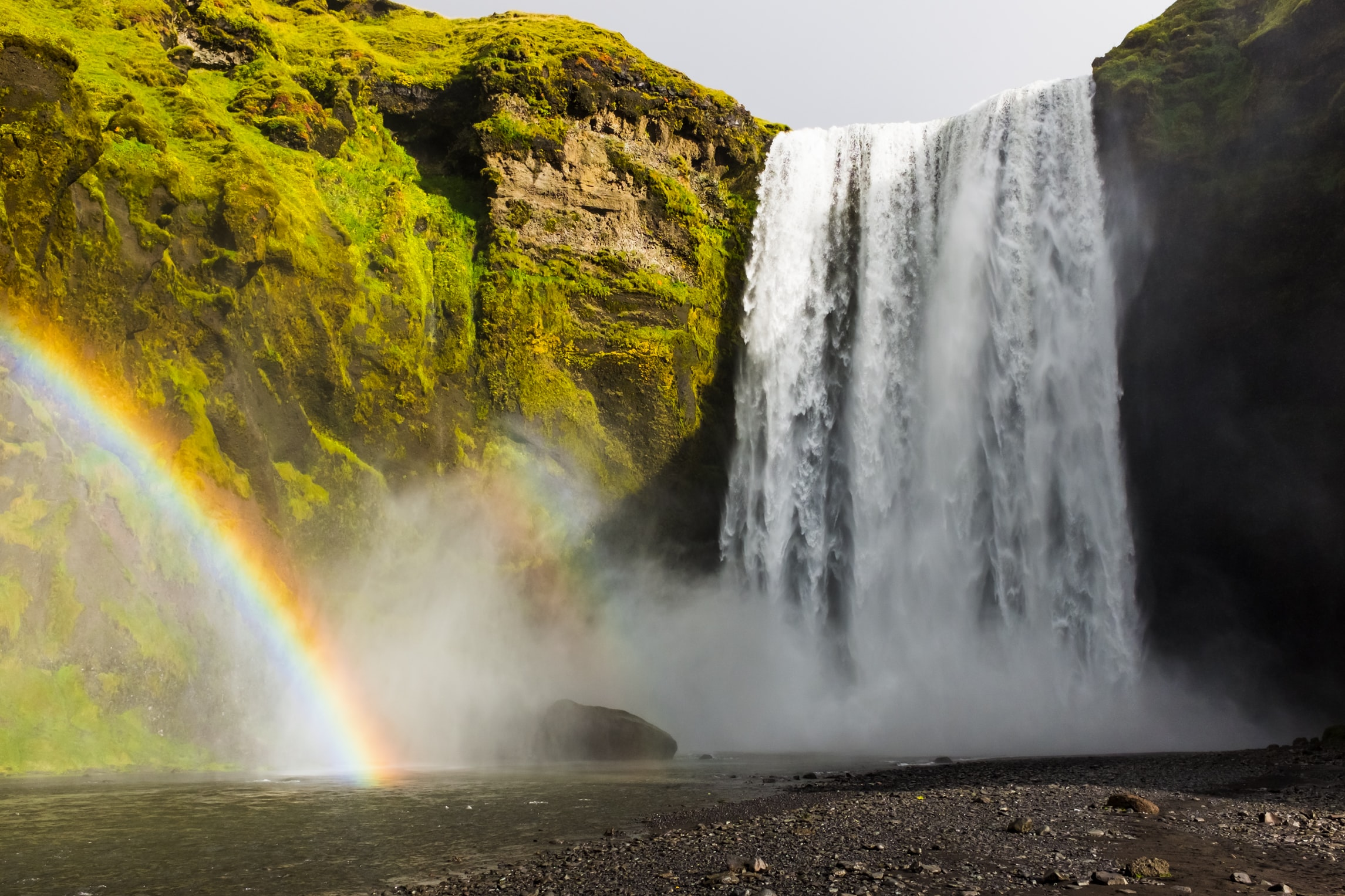 Skógafoss waterfall in Iceland with a rainbow